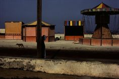 by Harry Gruyaert / Amusement stands near the beachfront, Essaouira, Morocco, 1988