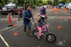 Towing mom around at the Bike Rodeo - photo by Jason Tinacci