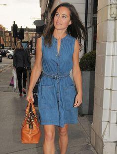 Proving that denim dresses can be super-polished, Pippa Middleton belts her sleeveless dress and adds a caramel-hued handbag for good measure.