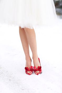 Gorgeous red bow Valentino heels in the snow via Inweddingdress.com #weddingshoes