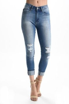 89a97826d3a7 Mid-rise stretch denim skinny jeans in a medium wash with fading and  whiskering throughout