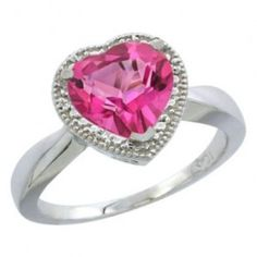 Pink Topaz Heart Shape Diamond Engagement Ring - A unique & colorful piece comes with this vibrant Pink Topaz Heart Shape Diamond Engagement Ring stamped in 14k White Gold place in a 3-prong setting. It features a Pink Topaz Heart Shape gemstone set atop of the ring with White Round Brilliant cut accent stones. This Pink Topaz Heart ring comes with an SI1-SI2 in clarity & G-H in color & the total gem weight is equal to 2.0 carats. All of the diamonds are 100% natural. #unusualengagementrings Heart Shaped Rings, Heart Shaped Diamond, Heart Rings, Unusual Engagement Rings, Diamond Engagement Rings, Pink Topaz Ring, Beautiful Rings, Heart Shapes, White Gold