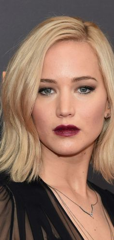 Jennifer Lawrence -- hooded eye makeup smokey cat eyes bold wine lip
