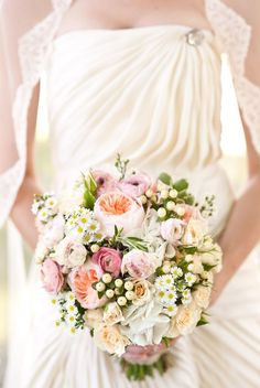 Delightful flowers!  Image via Style Me Pretty from August 22, 2011.