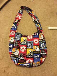A personal favorite from my Etsy shop https://www.etsy.com/listing/518359186/star-wars-the-empire-hobo-bag