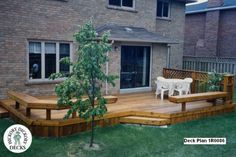Large, low, single-level deck with benches and a privacy screen (#1R0086).