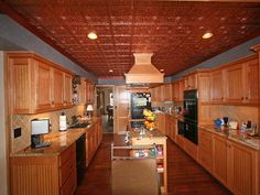 The Advantages Using Plastic Ceiling Tiles: Plastic Ceiling Tiles That Look Like Tin Installed In A Kitchen ~ gamesbadge.com Floor Inspiration