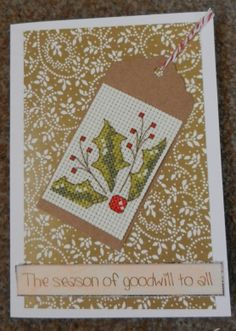 golden holly gift tag cross stitched christmas card.
