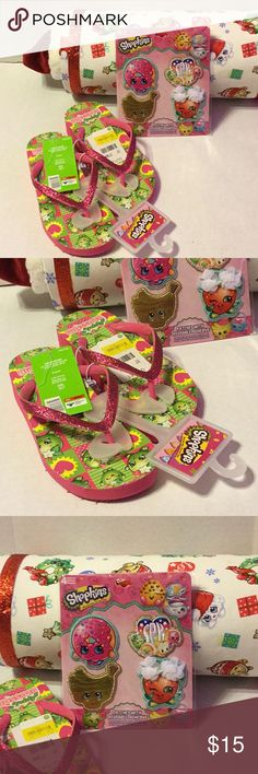 Shopkins Flip Flops New with tags. Pink sparkly flip flops, and 4 pack of patches. Sandals Available in 13/1 and 2/3. Cute Christmas gift idea for the little Shopkins fan! Ships next day! Shoes Sandals & Flip Flops