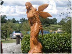 Welsh fairy Cora at gypsy wood park Wooden Sculptures, Cymru, Celtic Art, Cherubs, Wood Carvings, Outdoor Art, Tree Art, Faeries, Wood Art