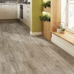 Bring your home up-to-date with the Quick-Step Livyn light grey oak vinyl flooring. Grey Laminate Flooring, Vinyl Flooring Kitchen, Luxury Vinyl Flooring, Luxury Vinyl Tile, Hardwood Floors, Conservatory Flooring, Grey Oak, Home Kitchens, Kitchen Remodel