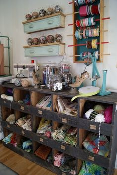 Craft room, I like the dresser drawer shelf idea!