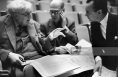 British composer Ralph Vaughan Williams (1872 - 1958, left) holds a discussion with conductor Malcolm Sargent (1895 - 1967, right) during a rehearsal for the world premiere of his 9th Symphony at the Royal Festival Hall in London, 2nd April 1958.