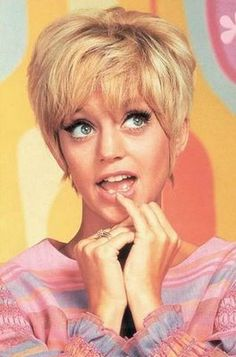 Goldie Hawn on Laugh In...flower power chick - my husband went to high school with her !