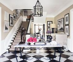 Traditional Staircase/Hallway by Dave DeMattei and Patrick Wade via @Architectural Digest #designfile  Black/white check floors