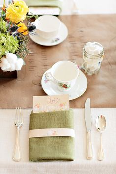 maybe we can make a table runner with pretty calligraphy. Write name of food or fun baby sayings.