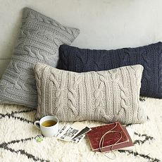 I should make a pillow cover out of the next sweater I'm discarding....(no knitting involved)