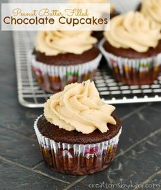 Chocolate #Cupcakes with a peanut butter truffle middle. . . topped with Peanut Butter Frosting. Heavenly! -from creationsbykara.com