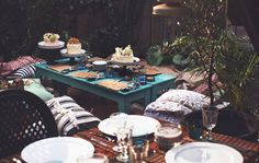 Adults and kids can have a dinner party together with a kids' activity table to keep them entertained. The kids table is laid and ready to go with activities, plus plenty of sweet things to eat, including three different cakes.