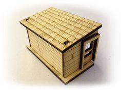 laser cut wooden shack cut from balsa