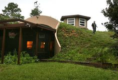 Loving Earth Sheltered Homes. After all of this research on off the grid homes I'm hands down going with an earth sheltered home. Something about being within the earth that's just inviting and gorgeous!