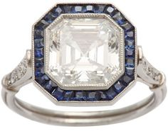 Art Deco emerald/ascher-cut diamond engagement with channel-set sapphires, set in platinum, 1930 http://www.ellew.com/pages_jewelry/1472_ascher_dia_ring.html