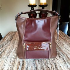 sale   NWT..Gussaci large brown tote  FLASH SALE 24 hours!!. $30 to $20!!!    NWT..Authentic Gussaci large brown tote. Beautiful 2-tone brown with gold hardware. Measures: 13.5 x 6 x 13.5. Gussaci Bags Totes