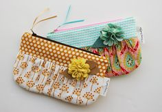 A feminine, fully lined, zippered clutch bag with a contrastingband along the top. Ideal for featuring that piece of treasured fabric you've been saving for something
