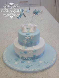 Baby boy blue christening cake with booties & cascading stars & crosses.  Ice Queen Cakes. Celebration Cakes Liverpool, St Helens, Wigan & Warrington www.icequeencakes.co.uk