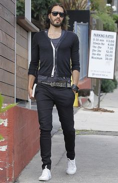 Hanging Loose! Russell Brand looks scruffy in baggy harem pants and no shoes as…