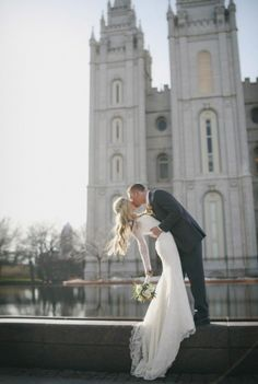 Perfect wedding kiss photo (and love her long sleeved dress)!