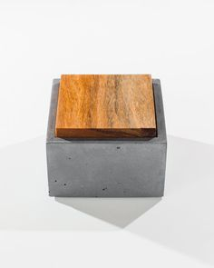 Hold your prized possessions in this small handmade grey square concrete box. A great place to store jewelry or small important items. Also great for