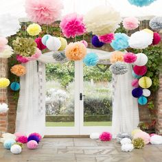 Decorate party venues and wedding venues with ease and with spectacular results with paper pom poms