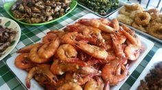 Filipino food at its best - shrimps, calamari, shells, grilled pork