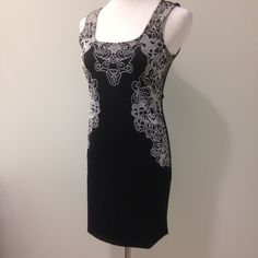 """Gorgeous black dress with raised design. Shown on a size medium. Please note this dress is quite form fitting and does not have """"give"""" even though the material is 95% polyester and 5% spandex. No trades. Casting LA Dresses"""