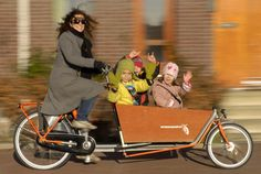 Yep, this is definitely typically Dutch: mothers stowing 3 of 4 kids in a 'bakfiets' #greetingsfromnl