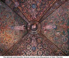 """This beautiful image displays a mosaic """"domed ceiling of the Mausoleum of Gala Placidia"""". The mosaic image displays animals, flowers, and angels, all of which are said to signify that """"Christ is the Lamb of God""""."""