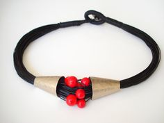 Handmade Necklace-German Silver Necklace-Hammered-Fold Formed-Linen Wax Cord-Red Beads-Modern Jewel-Contemporary Necklace-Statement necklace by AnnaRecycle on Etsy https://www.etsy.com/listing/182944848/handmade-necklace-german-silver-necklace