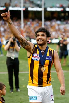 2015 Toyota AFL Grand Final - Hawthorn v West Coast - Cyril Rioli of the Hawks acknowledges the fans
