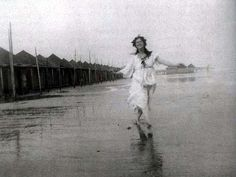 """""""To seek in nature the fairest forms and to find the movement which expresses the soul in these forms—this is the art of the dancer. ... My inspiration has been drawn from trees, from waves, from clouds, from the sympathies that exist between passion and the storm."""" So said Isadora: here she is on the Lido in Venice. Photo taken in 1903 by her brother Raymond Duncan."""
