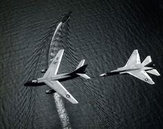 """""""Vigilante"""" refuels from an """"Skywarrior"""" high above its mobile Seventh Fleet airbase, USS Ranger 21 January NHHC Photographic Section, Navy Subject Files, Aviation. Fighter Pilot, Fighter Jets, Us Military Aircraft, Air Machine, Navy Aircraft Carrier, Naval History, United States Navy, Modern Warfare, Vietnam War"""