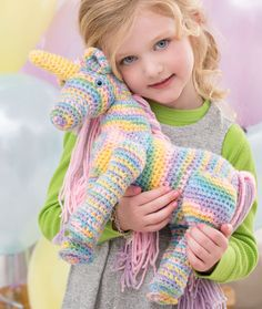 Free crochet pattern for an enchanting unicorn by Red Heart Yarns.
