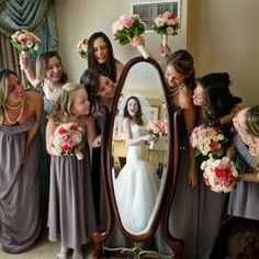 Nice photo idea: The bride in her reflection with bridesmaids surrounding it.