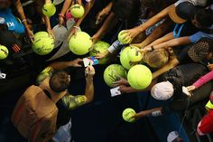Melbourne, Australia — Andy Murray of Great Britain signs autographs after winning his fourth round match against Gilles Simon of France during day eight of the 2013 Australian Open at Melbourne Park.  PHOTOGRAPH BY: Lucas Dawson / Getty Images