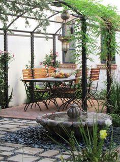 Garden ideas, Landscaping Ideas, arbor, pergola, Metal pergola, mediterranean patio, small space, smal yard, al fresco dining, climbing vines, garden structure, fountain, water feature, Carson Poetzl #PergolasPatio