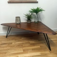 Broadwindsor Wooden Coffee Table from The Farthing: https://thefarthing.co.uk/products/toronto-triangle-wooden-occasional-table