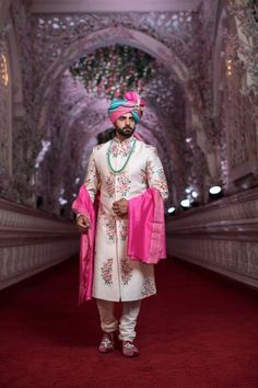 Looking for Pretty floral sherwani with pink and blue safa? Browse of latest bridal photos, lehenga & jewelry designs, decor ideas, etc. on WedMeGood Gallery. Couple Wedding Dress, Wedding Outfits For Groom, Groom Wedding Dress, Wedding Attire, Wedding Poses, Bridal Poses, Bridal Shoot, Wedding Videos, Wedding Wear
