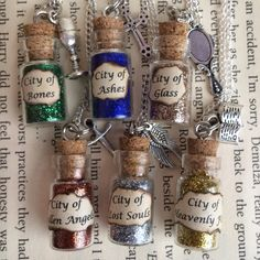 City of Bones , Ashes , Glass Bottle Necklace / Pendant / Bookmark / Earrings / Decoration / Keyring inspired by The Mortal Instruments by EnchantedBottleCraft on Etsy