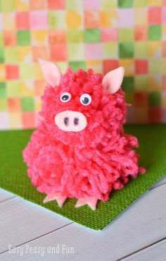 Make a pom pom pig. Such a cute pom pom craft.