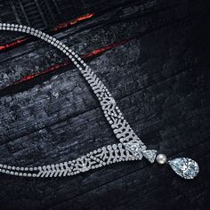 'The Cartier Pur Absolu Necklace' with a 30.21ct pear-shaped brilliant-cut diamond, which can also be set on a ring, and featuring a pearl, kite-shaped diamonds, pear-shaped diamonds, and brilliant-cut diamonds, set in platinum - for just two days, the Le Diamant exhibition opened its doors to a select few by appointment in London, Nov. 25, 2015
